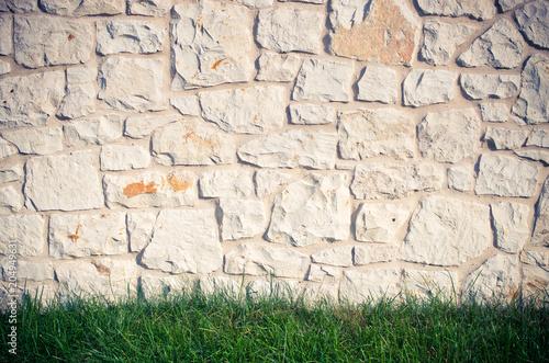 Fototapeta Stone wall and gras
