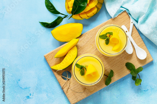 Homemade dessert panna cotta with mango jelly. Copy space, top view flat lay background. Traditional italian dessert.