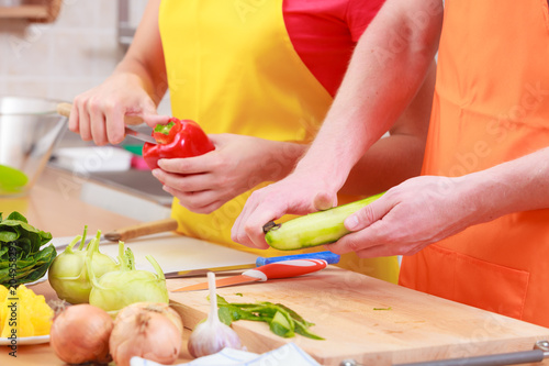Couple preparing fresh vegetables salad. Diet - 204958293