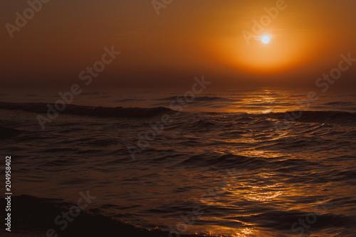 Plexiglas Strand Beatiful red sunset over sea surface