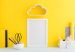 Quadro Creative desk  with yellow wall and supplies.