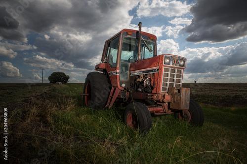 Aluminium Trekker Old red tractor in farmland, Warwick, Australia