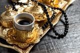 Black arabic coffee golden decorations rosary Ramadan kareem