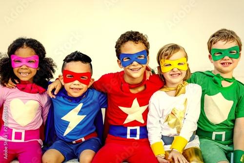 Superhero kids playing and having fun together