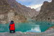 A woman watching turquoise Attabad lake , Gilgit, Pakistan