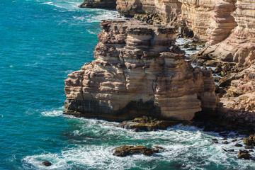 Travel View of Kalbarri Coastal Cliffs in Kalbarri, Western Australia. Landscape of turquoise Indian Ocean bay and sandstone rock cliff.