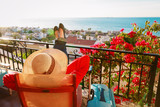 young woman tourist relax on scenic balcony terrace - 205025870