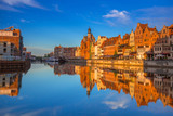 Beautiful old town of Gdansk reflected in Motlawa river at sunrise, Poland. - 205031261