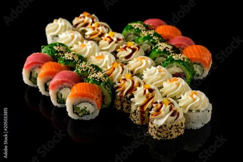 Fotobehang Sushi bar Fresh Sushi rolls set served on black background. Japanese seafood sushi
