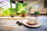 Sunglasses with vintage straw hat fasion on wooden table, Blur background for vintage resort hotel, Concept Summer - 205034291
