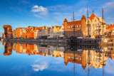 Beautiful old town of Gdansk reflected in Motlawa river at sunrise, Poland. - 205036042