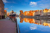 Beautiful old town of Gdansk reflected in Motlawa river at sunrise, Poland. - 205036090