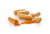 Turmeric capsules isolated on white. - 205042049