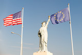 statue of liberty with american flag and european flags in Ellis Island - 205044819