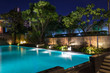 Leinwanddruck Bild - Lighting business for luxury backyard swimming pool.  Relaxed lifestyle with contemporary design by professionals.