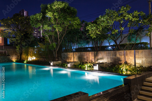 Leinwanddruck Bild Lighting business for luxury backyard swimming pool.  Relaxed lifestyle with contemporary design by professionals.