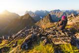 Photographer taking photo of sunset at Munkebu mountain in Lofoten