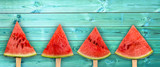 Four watermelon slice popsicles on panoramic blue wood background, fresh summer fruit concept - 205056423