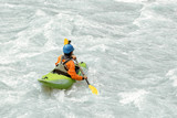 Kayaker paddling in white water rapids,  with copy space - 205056859