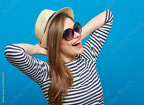Close up portrait of summer style casual dressed smiling girl.
