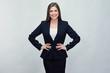 Woman wearing black business suit.