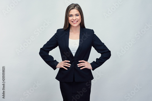 Woman wearing black business suit.