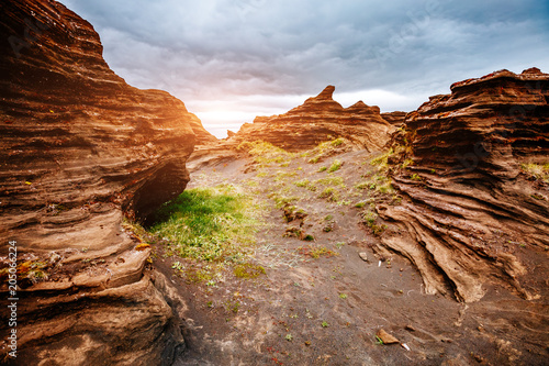 Sandy rocks with by magma formed by winds. Location place Sudurland, Iceland.