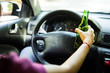 Driver drinking beer