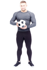 Isolated portrait of well-muscled male athlete holding soccer ball © White Background