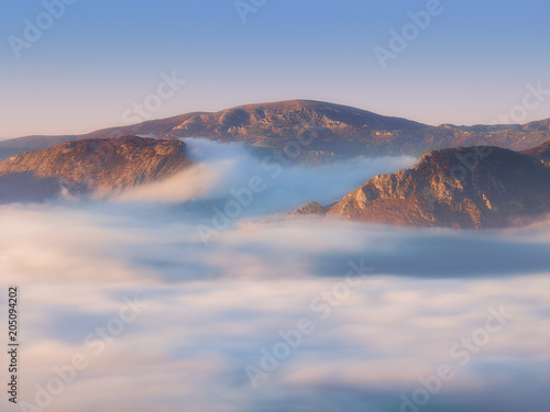 Fototapeta Urkiola and Gorbea mountains with fog at morning