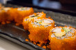 California maki sushi roll on black plate, japanese food