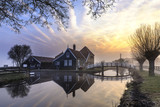 Beaucoutif typical Dutch wooden houses architecture mirrored on the calm canal of Zaanse Schans located at the North of Amsterdam, Netherlands - 205112887