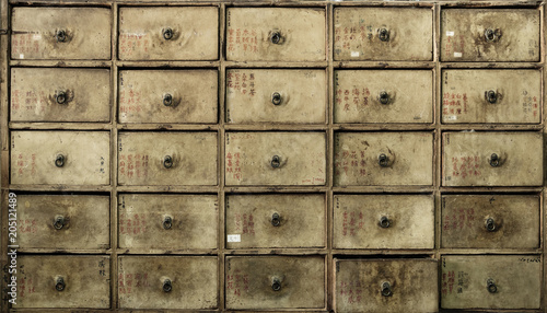 Fotobehang Konrad B. Apothecary asian drawers - retro furniture