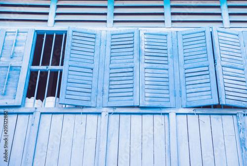 Plexiglas Konrad B. Facade of and old building, wide windows with open shutters