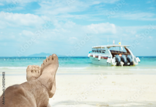 Fotobehang Konrad B. Conceptual picture of relaxing person on an asian beach
