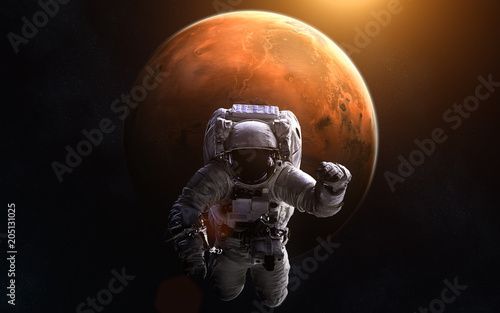 Canvas Nasa Astronaut on background of Mars. Image in 5K resolution for desktop wallpaper. Elements of the image are furnished by NASA