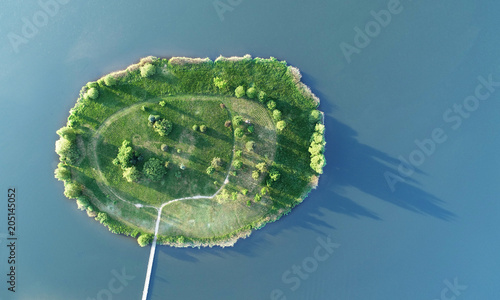 Small green island on the water - aerial view