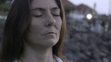 Close up of peaceful woman with closed eyes meditating outdoors - 205153484