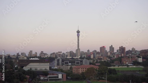 Johannesburg, South Africa, 26 April 2018 - A time-lapse of the sunset over Johannesburg's Hillbrow, featuring Hillbrow tower and Ponte City tower.