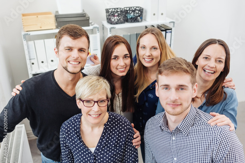 Happy group of office colleagues posing together - 205190467