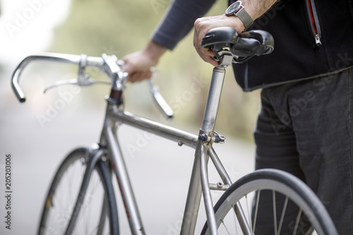 Man Holding Bike