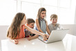 Group of curious children watching stuff on the laptop screen