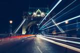 City light trails of traffic on Tower Bridge London at night