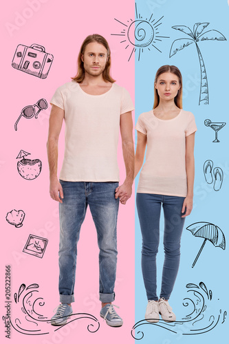 Poster Travelling together. Calm young couple wearing comfortable casual clothes and holding hands while being abroad