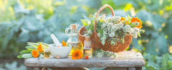 Spa composition with Fresh herbs, calendula and different types of oils. Shallow depth of field © valya82