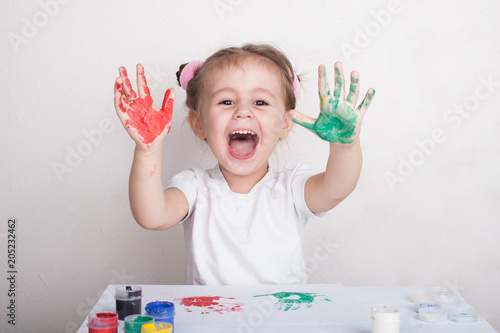 the child leaves his handprints on paper