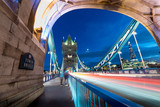 On tower bridge at night with moon