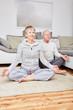 Quadro Senioren Paar macht Yoga Meditation
