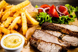 Grilled beefsteak with french fries and vegetables - 205241802