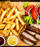 Grilled beefsteak with french fries and vegetables - 205241873